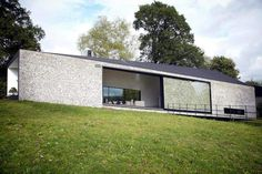 beautiful flint faced facade with amazing glass sliding door - shown on Grand Designs UK