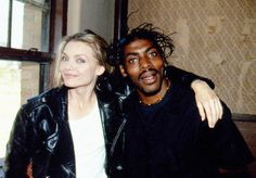 """Michelle Pfeiffer and Coolio pose for a photo on the set of the music video """"Gangsta's Paradise"""", 1995."""