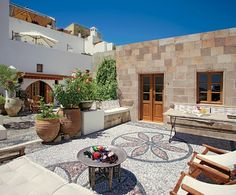 Courtyard of a Greek home with a beautiful mosaic floor.