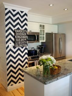 paint idea - paint chevron on wall at kitchen entry using the same gray and white as used for the hallway stripes.....maybe use the gray on the kitchen walls instead of white w/ accents of green