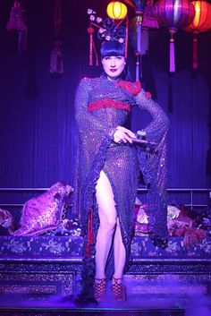 "Dita Von Teese smoldered in an Asian-inspired ensemble before stripping off her clothes during ""The Opium Den"" routine."