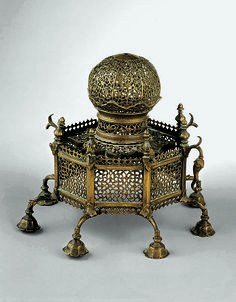 Incense burner in shape of an octagonal shrine Object Name: Incense burner Date: 17th century Geography: India, Deccan Culture: Islamic Medium: Brass Dimensions: H. 9 7/16 in. (24 cm) Diam. 7 1/16 in. (18 cm) Classification: Metal Credit Line: Private Collection, London