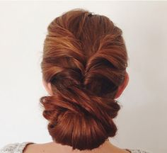 DIY a twisted low bun using this tutorial.