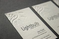 Debossed business cards: gives the card stock additional dimension, tactility and texturing.