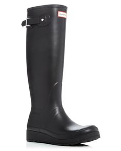 Hunter's classic tall boots, a rainy-day style staple, get a feminine lift from a low wedge heel. | Rubber upper, nylon lining, rubber sole | Imported | Fits large. If between sizes, order the next si