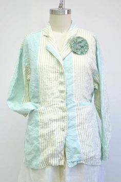 Features:     Conservative, boxy jacket   Great over anything   2 front welt pockets   Inside back drawstring   Hits at upper thigh   100%Striped Linen,Caribbean   Fits sizes 2-14