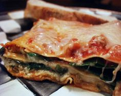 Quick & Easy Vegetarian Lasagna from Food.com:   This recipe substitutes ricotta cheese with tofu.  Don't tell anyone, and they'll never know the difference!  You can also add some meat-substitute (my favorite is Quorn grounds) to make what seems to be a meaty lasagna... and only you will know there's no meat in it!