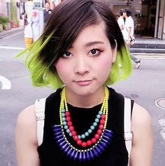 Miho's neon green hair caught our eye right away in Harajuku. The rest of her look includes a sleeveless top & acid wash denim skirt from Spinns & a statement necklace. Check her full look in this short street snap video: http://youtu.be/gx2TqxBOg1c