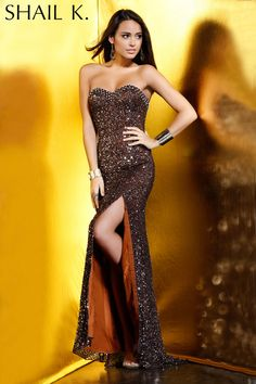 Shail K. style KK3133L is offered in three glamorous colors. This hand beaded gown will fit you like a glove and accentuate your curves! This style has a sexy high front slit.