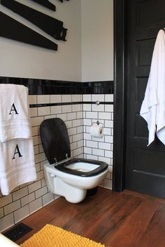 Petite Potties: Wall Hung Toilets | Apartment Therapy Yes, those are antique handsaws on the wall!