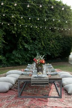Love using old Persian rugs in outdoor spaces~