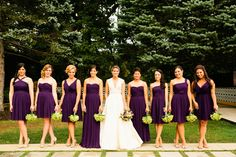 Dark purple dresses with green bouquets.. i like the idea of the dresses being different styles