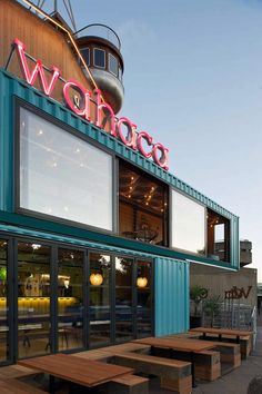 'wahaca mexican restaurant' has just opened a shipping container pop-up location in london's southbank, designed by softroom architects.