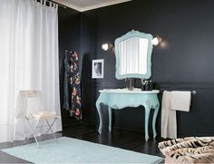 Bright furniture pops off of black walls - More decor ideas @BrightNest Blog