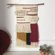 Handmade wall weaving. Natural South African wool, cotton, rope, wood46cm x93cm (including the fringes)