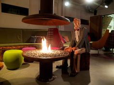 Mr. Woody gets warmed up by a fire at the Icelandair Hotel Reykjavik Marina, in Reykjavik, Iceland.   Photographed by Yvan Rodic