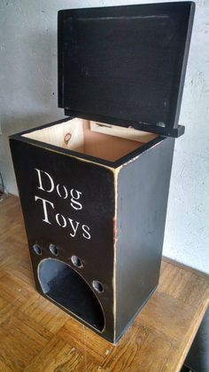 Handmade of 3/4 thick pine is this adorable dog toy box that feeds toys onto the bottom as you fill the box from the top so your doggy can pull them out easily! The top is a hinged lid. Box is 18 tall x 11 1/4 wide x 10 deep! Dont continue to trip on all your dogs toys laying all