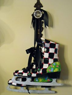 Old ice skates hand painted by an Etsy artist hanging on a vintage door knob. I love these!