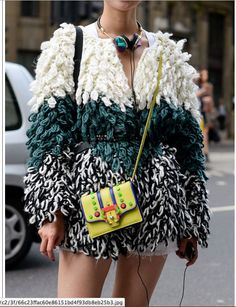 Street style of this voluminous sheep dog looking sweater. Totally works with skinny belt, large pendant necklace and colorful crossbody small purse.