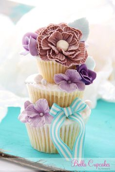 Tiered Cupcakes: A Bridal Shower Treat  Just a few around outsides and top of cupcake rack to add texture/depth?