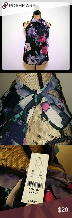 NWT NewYork & Company Floral Sleeveless Blouse! New York & Company floral sleeveless blouse brand new with tags! Synched bottom and tie around neck. Color is navy blue with pink and purple flowers. Size Large. New York & Company Tops Tank Tops