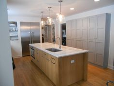 white countertop with wood base, contrasting with painted built-in cabinets