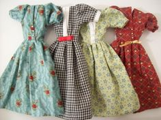 These look like the homemade dresses for Barbie my Grandma & Great Grandma made for my sister and I.