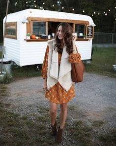 The Miller Affect wearing a reversible vest from LOFT and an orange floral dress