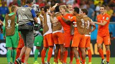 SALVADOR, BRAZIL - JULY 05: Netherlands players celebrate the win after the penalty shootout in the 2014 FIFA World Cup Brazil Quarter Final match between Netherlands and Costa Rica at Arena Fonte Nova on July 5, 2014 in Salvador, Brazil. (Photo by Alex Livesey - FIFA/FIFA via Getty Images)