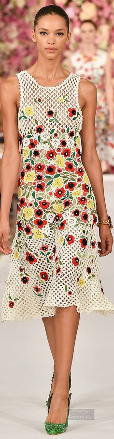 Oscar de la Renta Spring 2015 Ready to Wear. This crochet dress is inspired by 1970s hand-knit and crochet fashions. After the Vietnam War, Oil Crisis, and start of the recession in 1971, consumers were left with a distaste for haute couture and wastefulness. Instead, consumers turned to DIY and made their own garments by knitting, patch-working, and crocheting.
