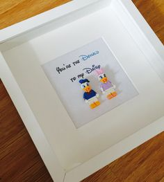 Disney Themed Lego Minifigure Shadowbox Frame. Choose from Mickey & Minnie Mouse, or Donald & Daisy Duck.  Frames available in either black or white. Text is fully customisable. We have the perfect Disney style font available to compliment your frame. Ideal as a Wedding, Anniversary, Engagement or Valentines gift.  £35 + P&P