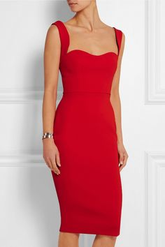 Victoria Beckham's silhouette-skimming dress is crafted from smoothing crepe in a fiery red hue. It's designed with a feminine sweetheart neckline and two-way zip through the back that can create a deep or subtle slit.