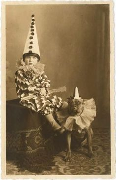 This cute vintage Halloween photo features a little clown and his dog.