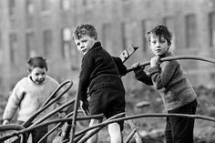 Youngsters at play on wasteground in the city.
