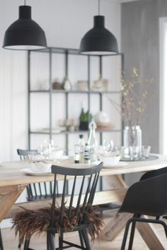 old wooden table, black chairs, Muuto pendants. from Bengtgarden