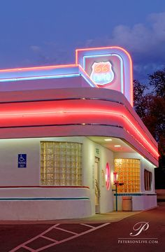 66 Diner, Route 66, (Central Ave.) Albuquerque, New Mexico. With its beautiful neon accents and curving retro lines, it looks especially appealing just after sunset.