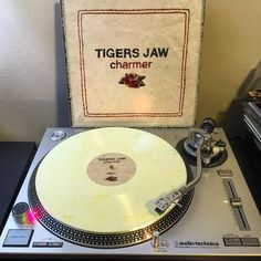 Now Playing - Tigers Jaw - Charmer (2014) Newbury Comics exclusive cream with green marble /1050 by pjc1190