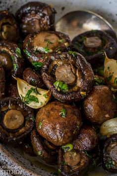 Roasted Mushrooms in a herbaceous garlic butter sauce, steakhouse style! Recipe from ThisSillyGirlsKitchen.com