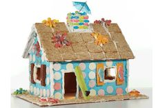 "The reusable gingerbread house...The Candy makes the perfect summer activity and a cute centerpiece for your family gatherings. We like to call this one ""The Surf Shack""!"