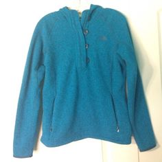 The North Face hooded sweatshirt The North Face turquoise hooded sweatshirt. 4 buttons down the front. Pockets on the front. Polyester. NWOT. Offers are always considered. The North Face Tops Sweatshirts & Hoodies
