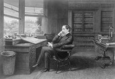 Charles Dickens in his later years, at his desk.