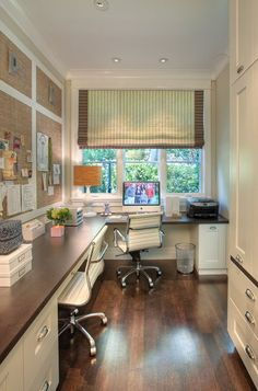 love dark wood floor and desktop with white chairs