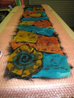 We spent a lovely morning and afternoon making these nuno felted Mosaic Scarves.used silk gauze and fine merino wool. Book Crafts, Felt Crafts, Craft Books, Nuno Felt Scarf, Felted Scarf, How To Make Scarf, Needle Felting Tutorials, Textile Fiber Art, Nuno Felting