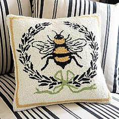 hand hooked bee pillow