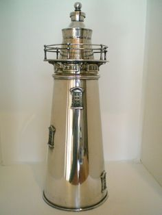 Rare original huge 1927 International Silverplate Lighthouse shaker. It is staggeringly tall. It is so huge that there is actually a handle on the bottom to hold on to while shaking.