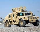 Image of the HMMWV M1114 UAH (Up-Armored Humvee) Up-Armored HMMWV Armament Carrier