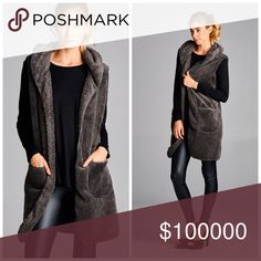 Available Saturday! Lush/warm chic charcoal vest Loose fit, sleeveless, hooded long vest. Open closure. Front pockets at waist. Above the knee length. This hooded long vest is made with very soft, fluffy faux fur that is lush, very warm, and light in weight. Jackets & Coats Vests