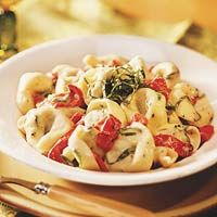 Tortellini Alfredo with Roasted Peppers - To make this delicious dinner, add sweet red peppers, light Alfredo sauce, basil, and coarsely ground black pepper to packaged cheese-filled tortellini.