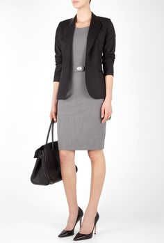 A business dress paired with a fitted black blazer is a great look for a business professional environment.