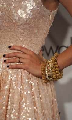 Four diamond and gold bracelets by Neil Lane. And delicious pink sequined gown